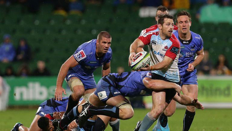 Waratahs fly-half Bernard Foley looks to pass the ball