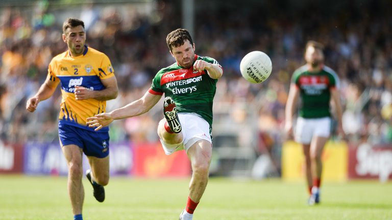 Chris Barrett of Mayo in action against Dean Ryan of Clare during the GAA Football All-Ireland Senior Championship Round 3A match