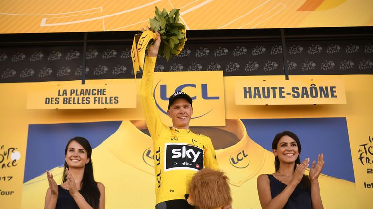 Chris Froome salutes the crowd after taking the overall lead in the Tour deFrance