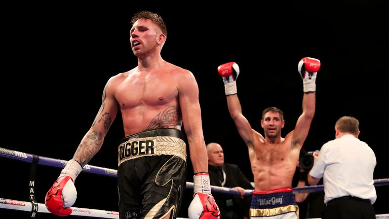Buglioni raises his arms in celebration