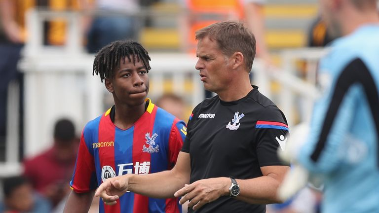 Crystal Palace manager Frank de Boer gives instructions to Jason Lokilo during a pre-season game at Maidstone