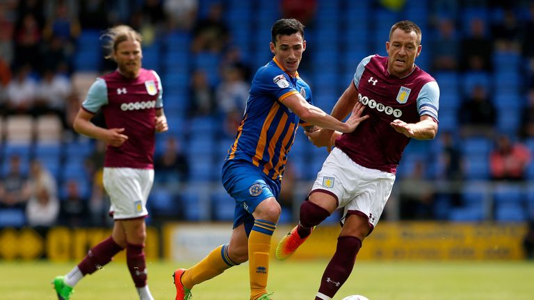 John Terry, making his first appearance for Aston Villa, battles with Louis Dodds of Shrewsbury during the Championship side's pre-season defeat