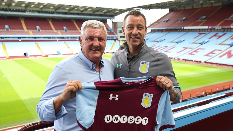 John Terry and manager Steve Bruce pose for a photo at Villa Park