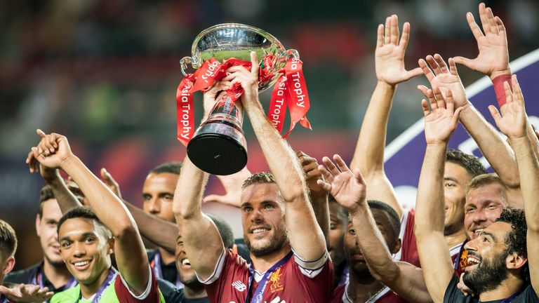 Jordan Henderson lifts the Premier League Asia Trophy