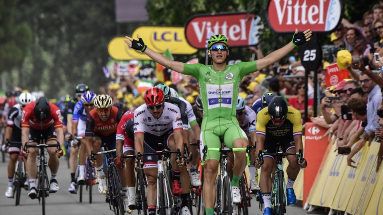 Marcel Kittel celebrates as he crosses the finish line ahead of Germany's John Degenkolb and Dylan Groenewegen