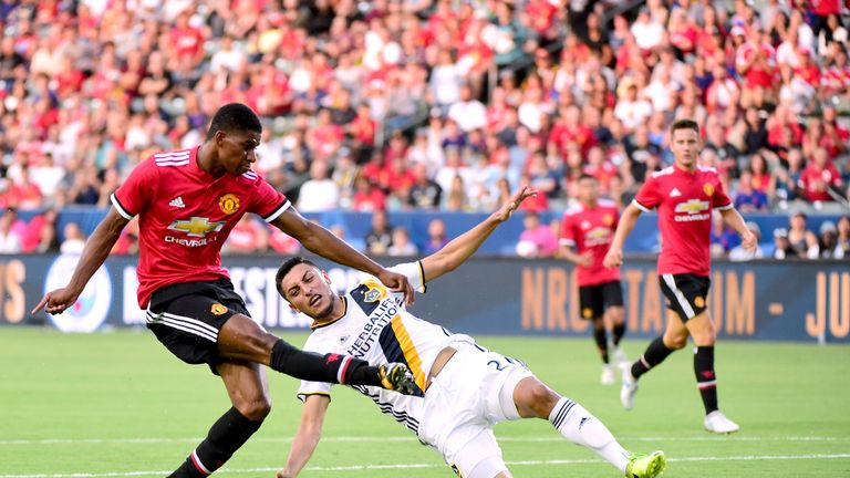 Rashford scores his second goal of the game past Hugo Arellano of LA Galaxy