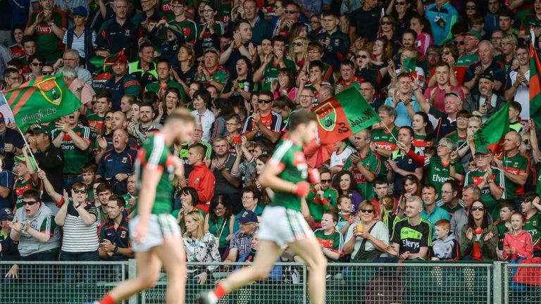 Mayo supporters encourage their side at half-time
