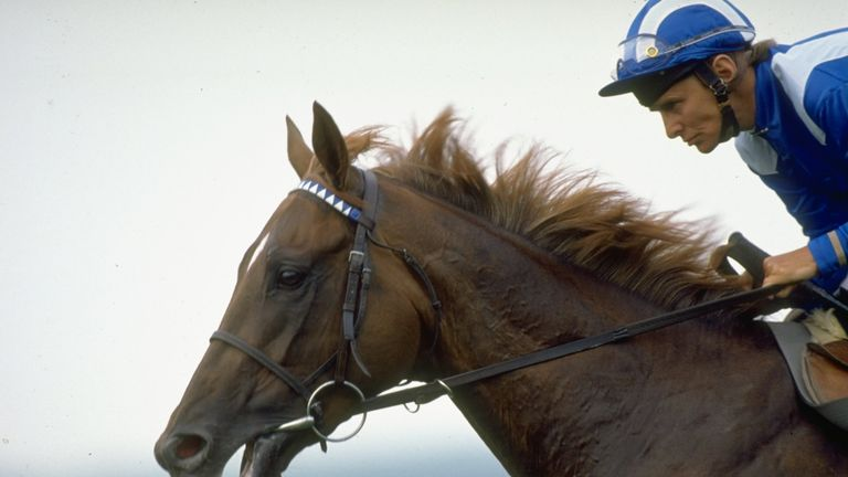 Nashwan and Willie Carson in winning action.