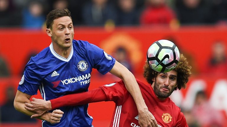 Nemanja Matic vies with Manchester United's Marouane Fellaini