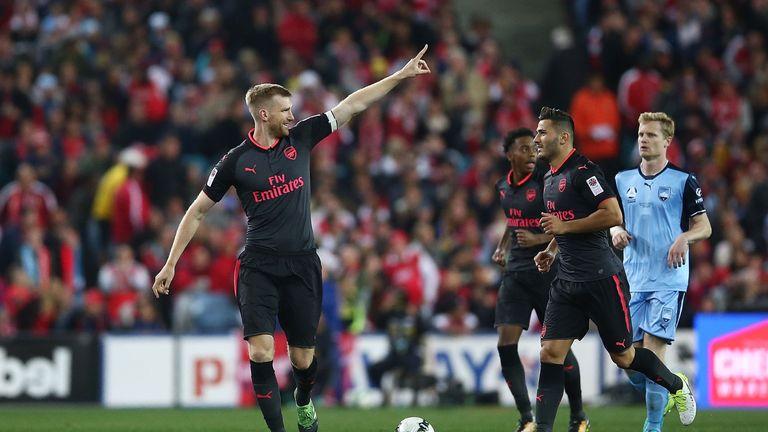 Per Mertesacker celebrates his acrobatic opener for Arsenal in their pre-season friendly against Sydney FC