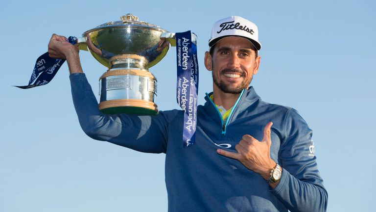 Rafa Cabrera Bello proudly displays the Scottish Open trophy after his success
