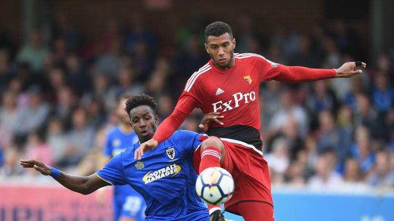 Raoul Esseboom of Wimbledon battles Etienne Capoue of Watford during a pre-season friendly