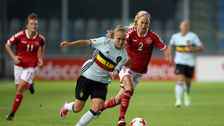 Janice Cayman of Belgium and Line Roddik Hansen of Denmark tussle during the match