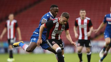 Caolan Lavery and Saido Berahino battle for possession