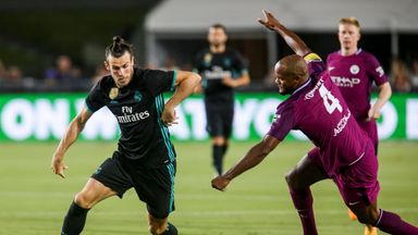 Real Madrid goalkeeper Keylor Navas (L) and Manchester City defender Vincent Kompany vie for the ball during their International Champions Cup (ICC) footba