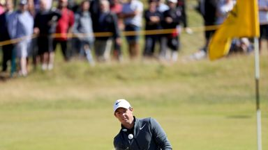 Rory McIlroy hits a bunker shot