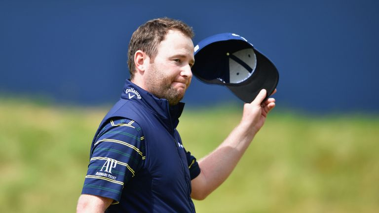 Branden Grace of South Africa acknowledges the crowd on the 18th green after shooting a 62, the lowest round in major history, at The 146th Open