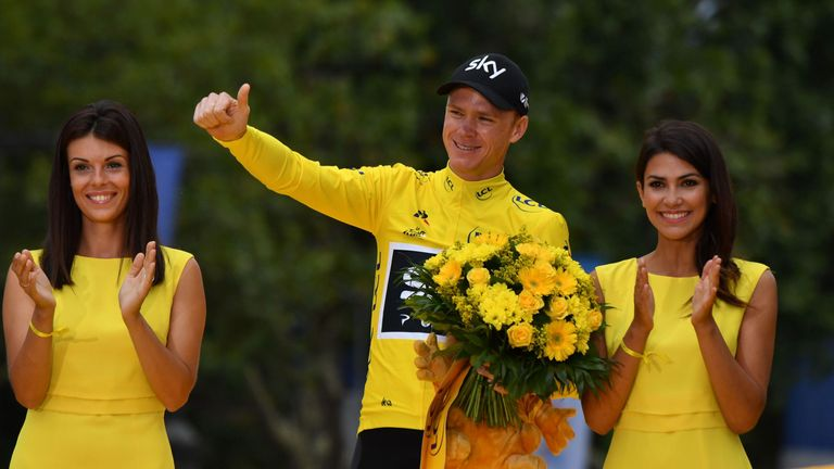 Tour de France 2017's winner Great Britain's Christopher Froome celebrates his overall leader yellow jersey on the podium at the end of final stage