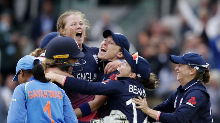 England's Anya Shrubsole (C) celebrates as she takes the wicket of India's Rajeshwari Gayakwad (L) to win the ICC Women's World Cup cricket final