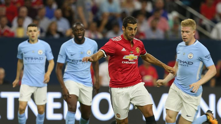 HOUSTON, TX - JULY 20:  Henrikh Mkhitaryan of Manchester United in action with Tosin Adarabioyo of Manchester City during the