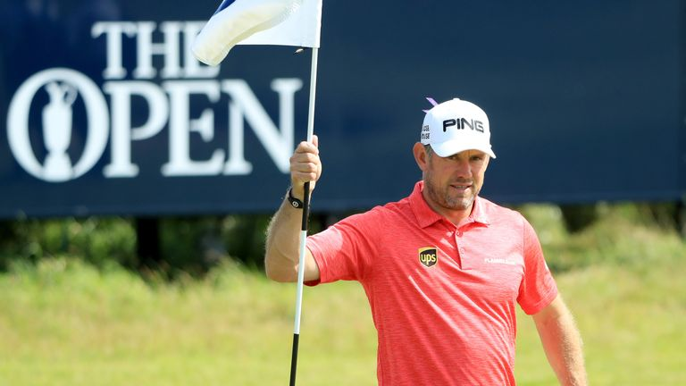 SOUTHPORT, ENGLAND - JULY 18:  Lee Westwood of England tends a pin flag during a practice round prior to the 146th Open Championship at Royal Birkdale on J