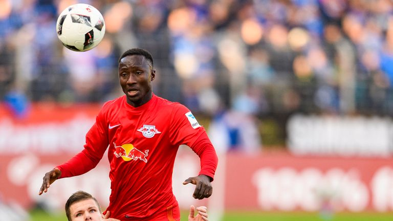 Naby Keita of Leipzig challenges Roman Bezjak of Darmstadt during the Bundesliga match between SV Darmstadt 98 and RB Leipzig