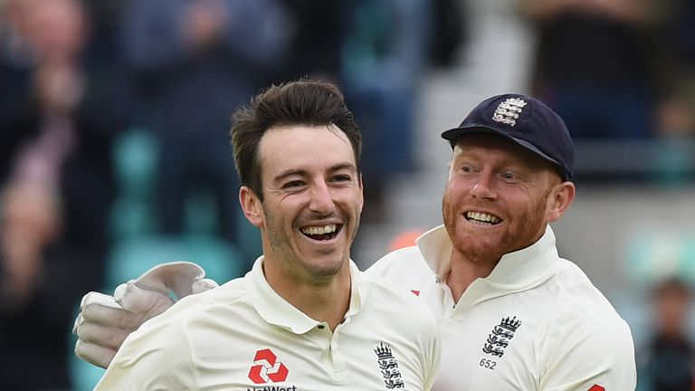 LONDON, ENGLAND - JULY 28:  Toby Roland-Jones of England celebrates with Jonny Bairstow