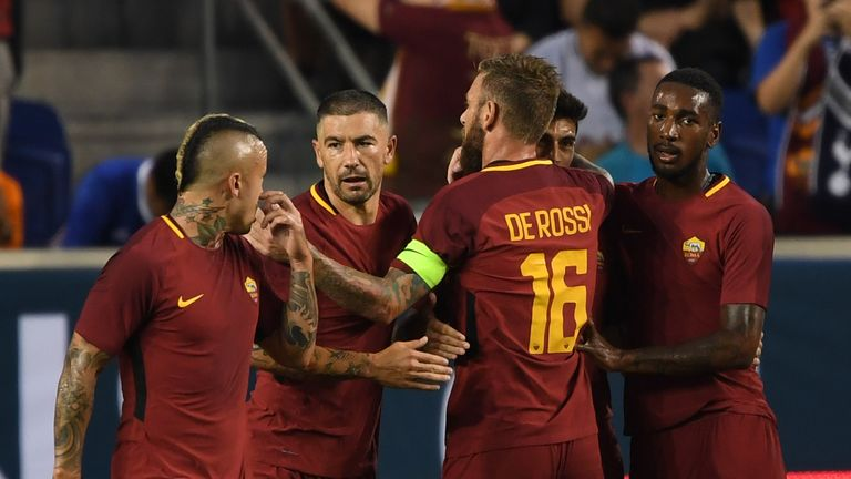 A.S. Roma players celebrate a goal during their International Champions Cup (ICC) football match between Tottenham and A.S. Roma on July 25, 2017 at Red Bu