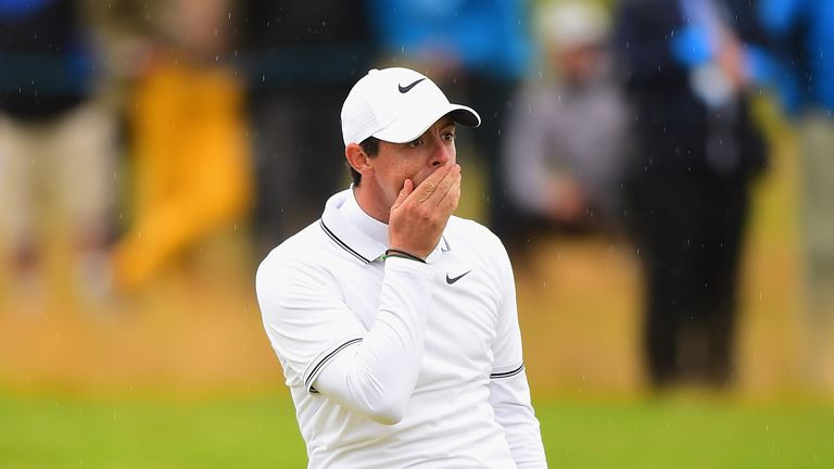 TROON, SCOTLAND - JULY 14:  Rory McIlroy of Northern Ireland reacts after playing his second shot on the 18th fairway during Day Two of the AAM Scottish Op