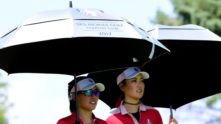 Kang and Michelle Wie shield themselves from the heat as they won the top fourballs match