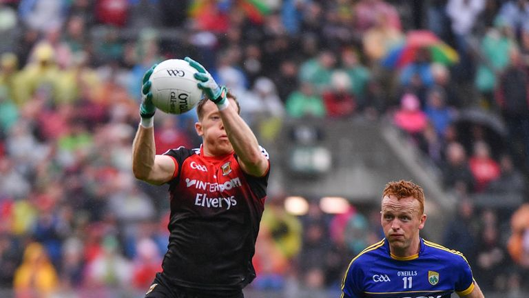 Mayo's Donal Vaughan in action against Johnny Buckley of Kerry