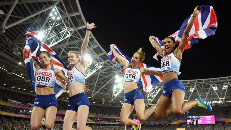 The British team celebrate silver in the women's 4x400m