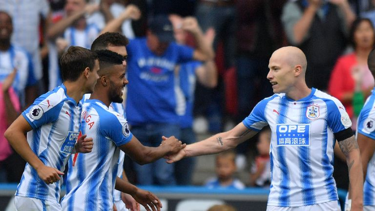 Aaron Mooy (right) celebrates with teammates  after giving his side the lead
