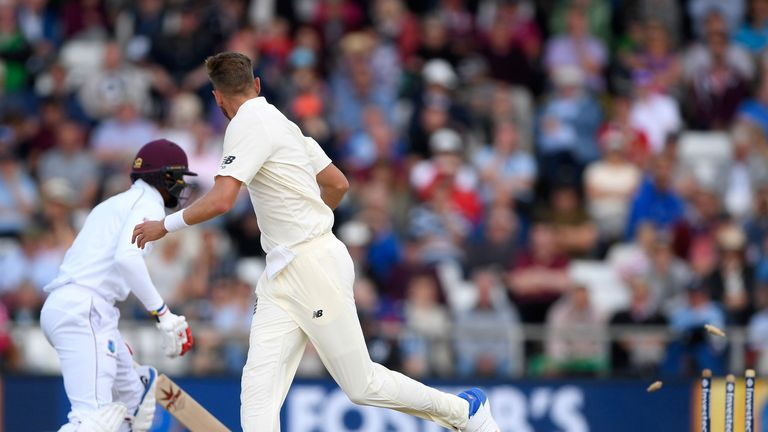 Stuart Broad looks back after dropping Kraigg Brathwaite to see Kyle Hope run out