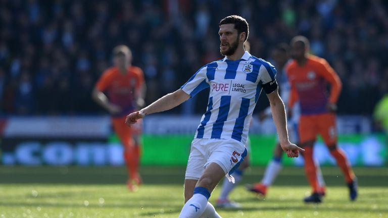 Huddersfield's Hudson retires, joins coaching staff