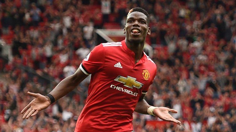 Paul Pogba celebrates after scoring United's fourth goal