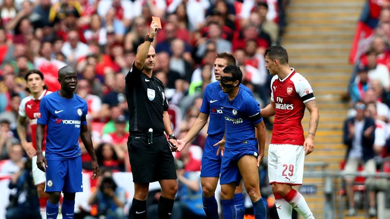 Referee Bobby Madley issues a straight red card to Chelsea forward Pedro
