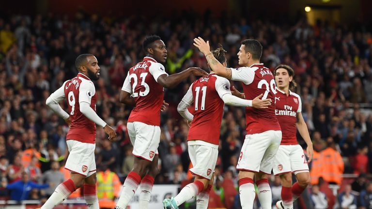 Danny Welbeck celebrates with team-mates after equalising late in the first half