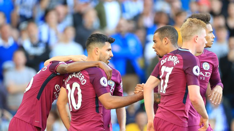 Manchester City's Sergio Aguero (centre) celebrates scoring his side's first goal