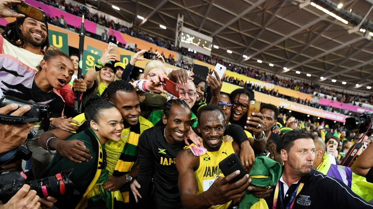 Bolt celebrates with Jamaica supporters after his defeat in the Olympic Stadium