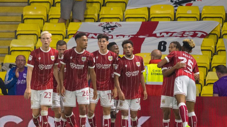 Bristol City's Bobby Reid (second right) celebrates scoring his side's second goal at Watford