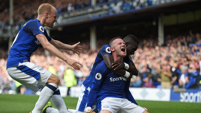 Rooney celebrates after scoring the winner on his Premier League return to Everton