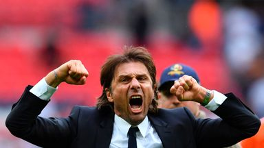 Antonio Conte celebrates on the pitch at the end of the game against Spurs