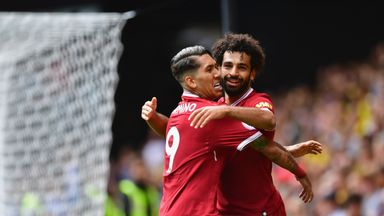Mohamed Salah celebrates Liverpool's third with Roberto Firmino