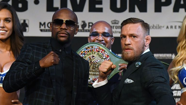 LAS VEGAS, NV - AUGUST 23:  Boxer Floyd Mayweather Jr. (L) and UFC lightweight champion Conor McGregor (R) pose as Mayweather Promotions CEO Leonard Ellerb