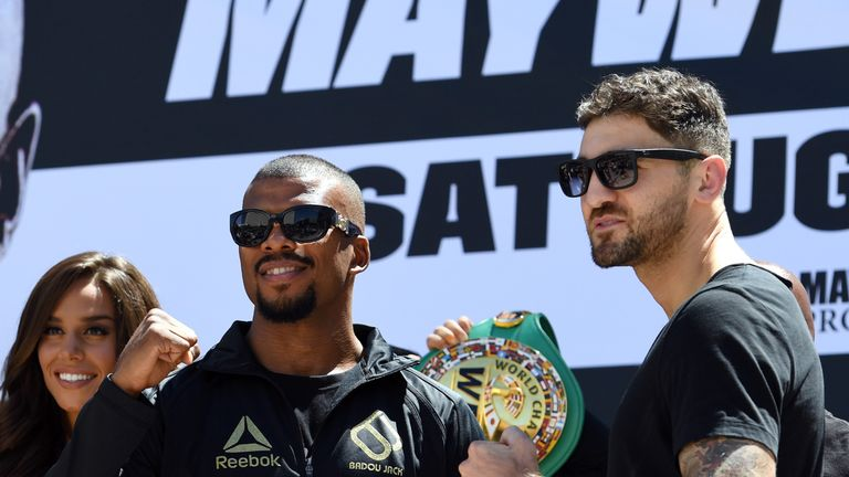 Boxers Badou Jack (L) and WBA light heavyweight champion Nathan Cleverly pose after arriving at Toshiba Plaza on August 22, 2017.