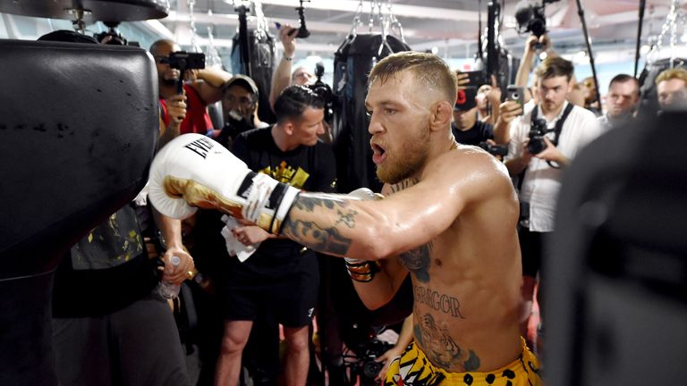 UFC lightweight champion Conor McGregor hits an uppercut bag during a media workout at the UFC Performance Institute on August