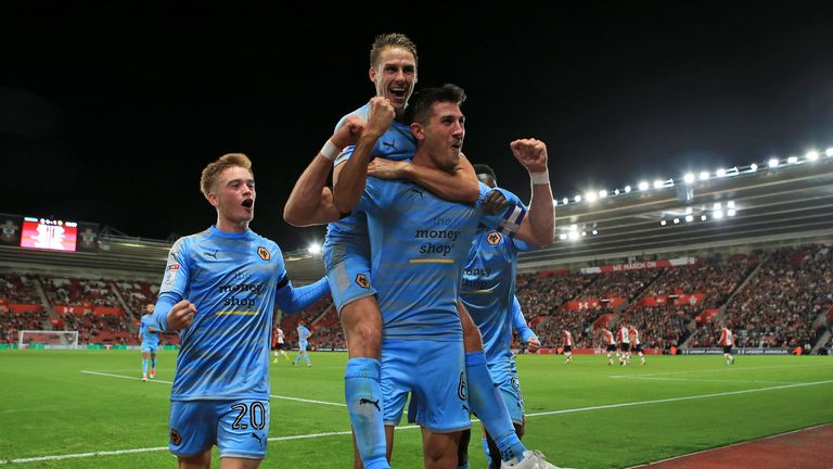 Wolves' Danny Batth (centre) celebrates scoring his side's first goal during the Carabao Cup, Second Round match at St Mary's Stadium, Southampton