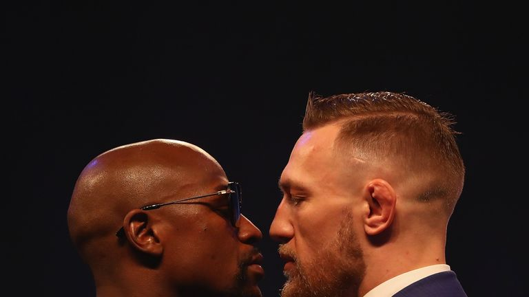 LONDON, ENGLAND - JULY 14: Floyd Mayweather Jr. and Conor McGregor come face to face during the Floyd Mayweather Jr. v Conor McGregor