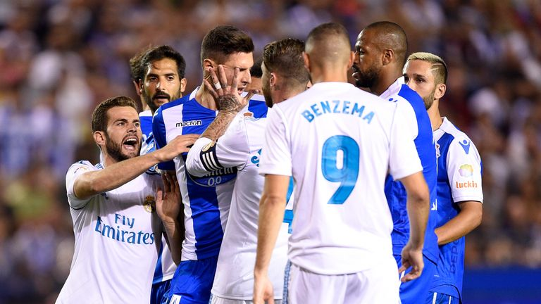 Fabian Schar gets involved in an altercation with Sergio Ramos during the La Liga match at the Santiago Bernabeu